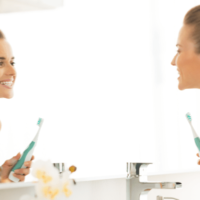 woman brushing teeth preventing gum disease