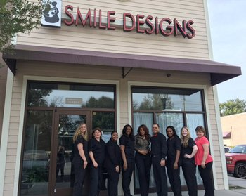 Dental team standing in front of Smile Designs by Dr. Karen Cooper, top dentist in Savannah, GA