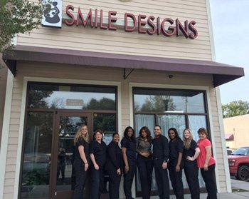 Dental team standing in front of Smile Designs by Dr. Karen Cooper, top dentist in Savannah, GA
