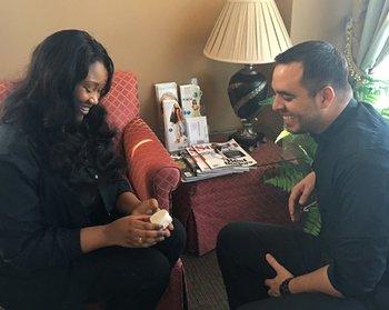 Two people sitting and laughing in waiting room of top cosmetic dentist in Savannah, GA, Dr Karen Coope