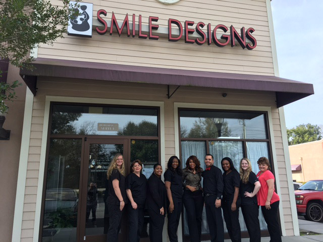 Dr. karen copper and her smile team standing in front of her Savannah GA dental office