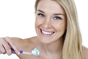 Woman ready to brush her teeth