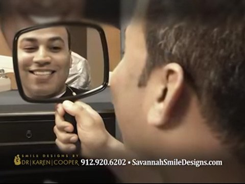 Man looking at his teeth in mirror video preview